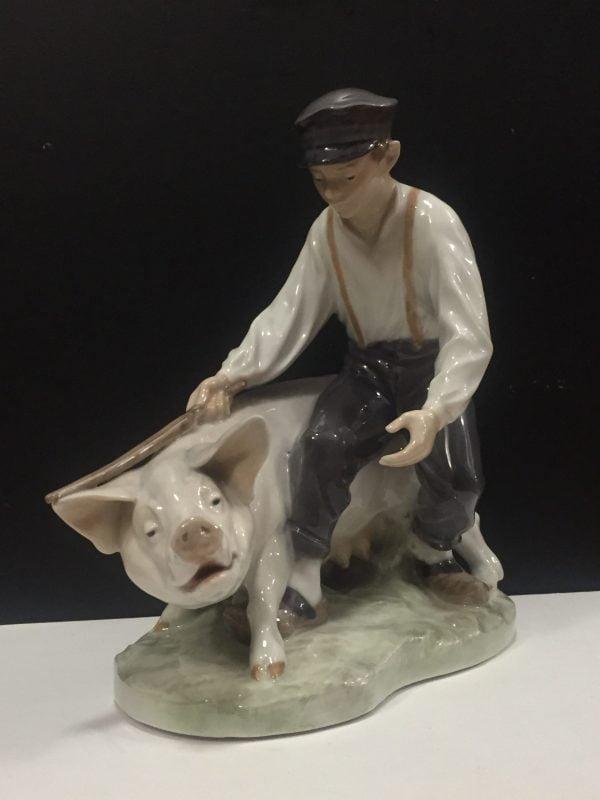Dreng med gris